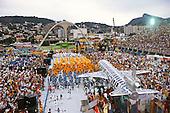 Rio de Janeiro, Brazil. Samba dancers during the carnival parade; float with aeroplane.
