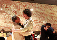 From left, Angela Davis dances with her legally-married partner Doron Samuel-Seigel during a private ceremony held earlier this year for family and close friends. Photo/Andrew Shurtleff