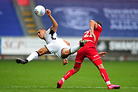 Ben Cabango of Swansea City is fouled by Nahki Wells of Bristol City during the Sky Bet Championship match between Swansea City and Bristol City at the Liberty Stadium in Swansea, Wales, UK. Saturday 18 July 2020