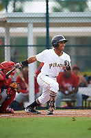 GCL Pirates right fielder Edison Lantigua (10) at bat during a game against the GCL Phillies on August 6, 2016 at Pirate City in Bradenton, Florida.  GCL Phillies defeated the GCL Pirates 4-1.  (Mike Janes/Four Seam Images)