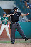 Home plate umpire Tyler Witte calls a batter out on strikes during the game between the Hudson Valley Renegades and the Greensboro Grasshoppers at First National Bank Field on September 2, 2021 in Greensboro, North Carolina. (Brian Westerholt/Four Seam Images)