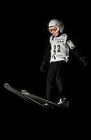 Fabian Andersen, nine years old, flies through the night air in  the old Schroderbakken ski jump.