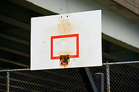 Rims are removed from basketball backboards at a basketball court in the Bloomfield neighborhood on Tuesday March 31, 2020 in Pittsburgh, Pennsylvania. (Photo by Jared Wickerham/Pittsburgh City Paper)