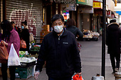 New York, New York<br /> March 18, 2020<br /> 1 PM<br /> <br /> <br /> Manhattan under coronavirus pandemic. <br /> <br /> Man wearing face mask and gloves fearing the spread of the virus in downtown Manhattan.