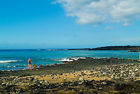 Two people stand near the shore of remote Beau Chien beach at La Perouse Bay on the Makena coast of West Maui.