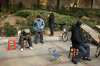 CHINA. Hubei Province. Wuhan. Men gather in a park. Wuhan (population 4.3 million) is a sprawling city that sits on both sides of the Yangtze River.  2008