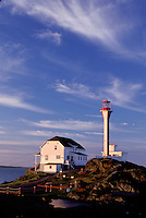 lighthouse, Nova Scotia, Yarmouth, NS, Canada, Cape Forchu Lighthouse along the coast in Yarmouth at sunrise on the Atlantic Ocean.