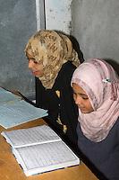 Surman, Libya.  Girls Memorizing the Koran in the Madrasa of Sidi Rashid al-Galili.  Young girls wear the traditional Libyan head scarf.