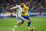 Daniel Carvajal of Real Madrid competes for the ball with Jese Rodriguez of UD Las Palmas  during the match of Spanish La Liga between Real Madrid and UD Las Palmas at  Santiago Bernabeu Stadium in Madrid, Spain. March 01, 2017. (ALTERPHOTOS / Rodrigo Jimenez)