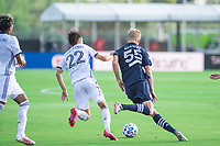 LAKE BUENA VISTA, FL - JULY 9: Keaton Parks #55 of NYCFC dribbles the ball during a game between New York City FC and Philadelphia Union at Wide World of Sports on July 9, 2020 in Lake Buena Vista, Florida.