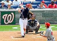 4 July 2009: Washington Nationals outfielder Adam Dunn hits his 300th career home run against the Atlanta Braves at Nationals Park in Washington, DC. Dunn also hit the game winning RBI single as the Nationals rallied with 4 runs in the 8th inning to defeat the Braves 5-3 and take the second game tying the 3-game weekend series. Mandatory Credit: Ed Wolfstein Photo