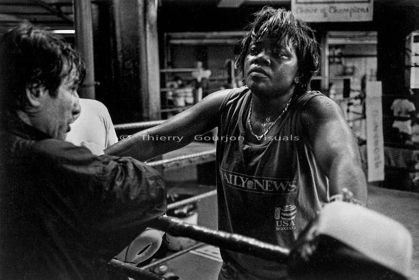 Veronica Simmons in between rounds at Gleason's Gym in Brooklyn, New york.<br />Photograph by Thierry Gourjon-Bieltvedt 1995-2005