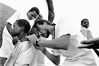 Mozambique. Province of Maputo. Moamba is a small town (150 km from the caiptal).  A white doctor (expatriate) practises a medical consultation on a young woman who suffers from a filariose.The filariose is a serious tropical disease due to a worm which did enter in the body. Beacause of the war between the Government and the rebel of the Frelimo party, the roads are either mined or too dangerous to travel on. Moamba can only be reached by plane. The non governmental organisation (ngo) Médecins Sans Frontières (MSF) of Spain has rehabilitated the hospital. © 1992 Didier Ruef