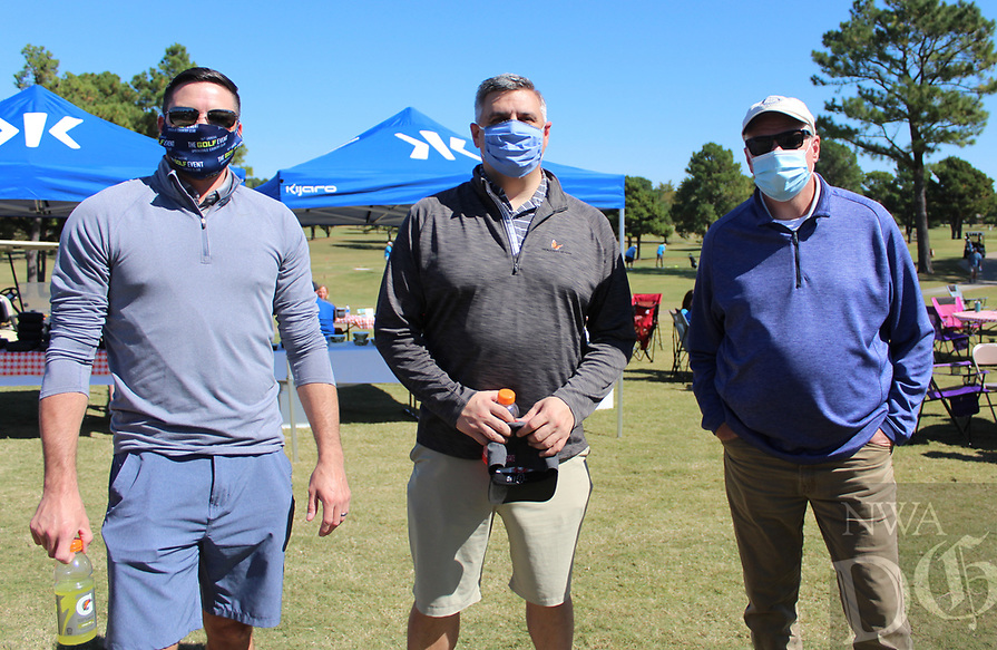 Chris Hudgens (from left), Heath Geiger and Jim Widmer of Tyson Foods help support the Jones Center at The Golf Event.<br /> (NWA Democrat-Gazette/Carin Schoppmeyer)