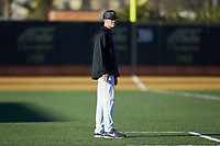 Wake Forest Demon Deacons head coach Tom Walter (16) coaches third base during the game against the Gardner-Webb Runnin' Bulldogs at David F. Couch Ballpark on February 18, 2018 in  Winston-Salem, North Carolina. The Demon Deacons defeated the Runnin' Bulldogs 8-4 in game one of a double-header.  (Brian Westerholt/Four Seam Images)