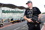 Pix: Shaun Flannery/shaunflanneryphotography.com...COPYRIGHT PICTURE>>SHAUN FLANNERY>01302-570814>>07778315553>>..9th July 2007..............An armed South Yorkshire Police Officer stands guard at Robin Hood Airport Doncaster Sheffield after recent terrorist attacks.