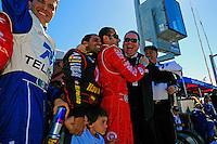 Juan Pablo Montoya, Dario Franchitti and Chip Ganassi celebrate victory.