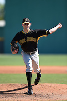 Pittsburgh Pirates pitcher Josh Smith (98) during a minor league spring training intrasquad game on March 30, 2014 at Pirate City in Bradenton, Florida.  (Mike Janes/Four Seam Images)