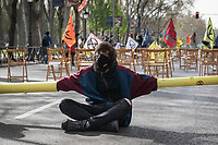 MADRID, SPAIN – MARCH 26: Activists of the XR group, they chain each other and cut the traffic paseo del prado while simulating an assembly as a protest against climate change on 26 march in Madrid, Spain. The international civil disobedience movement against the climate emergency Extinction Rebellion (XR) carries out this morning an act of participatory democracy in the street. It has been installed in front of the Ministry of Health, Consumption and Social Welfare to demand that the Citizen Assembly for the Climate, announced by the minister for the ecological transition in a few months, have a real mandate of decision.  (Photo by Joan Amengual / VIEWpress via Getty Images)