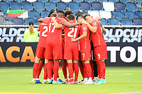 KANSAS CITY, KS - JULY 15: Canada players in a pre game huddle during a game between Canada and Haiti at Children's Mercy Park on July 15, 2021 in Kansas City, Kansas.