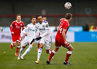 10th January 2021; Broadfield Stadium, Crawley, Sussex, England; English FA Cup Football, Crawley Town versus Leeds United; Hélder Costa of Leeds United clips a high ball over Craig of Crawley