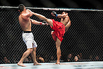 Jumabieka Tuerxun of China and Mark Eddiva of Philippines fight on their Featherweight Bout  3 Rounds during the UFC Fight Night at the Cotai Arena on 01 March 2014 in Macau, China. Photo by Victor Fraile / Power Sport Images