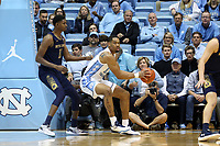 CHAPEL HILL, NC - NOVEMBER 06: Garrison Brooks #15 of the University of North Carolina backs up against Juwan Durham #11 of the University of Notre Dame during a game between Notre Dame and North Carolina at Dean E. Smith Center on November 06, 2019 in Chapel Hill, North Carolina.