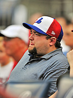 """25 September 2011: A fan sports a Montreal Expos """"Blue-Blanc-Rouge"""" cap as he watches the Washington Nationals play the Atlanta Braves at Nationals Park in Washington, DC. The Nationals shut out the Braves 3-0 to take the rubber match third game of their 3-game series - the Nationals' final home game for the 2011 season. Mandatory Credit: Ed Wolfstein Photo"""