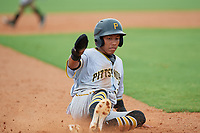 GCL Pirates Carlos Canache (13) slides into third base during a Gulf Coast League game against the GCL Rays on August 7, 2019 at Charlotte Sports Park in Port Charlotte, Florida.  GCL Rays defeated the GCL Pirates 5-3 in the second game of a doubleheader.  (Mike Janes/Four Seam Images)