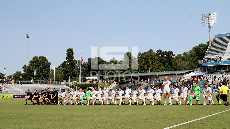 CARY, NC - SEPTEMBER 12: The players and staff of the Portland Thorns FC during the playing of the national anthem before a game between Portland Thorns FC and North Carolina Courage at Sahlen's Stadium at WakeMed Soccer Park on September 12, 2021 in Cary, North Carolina.