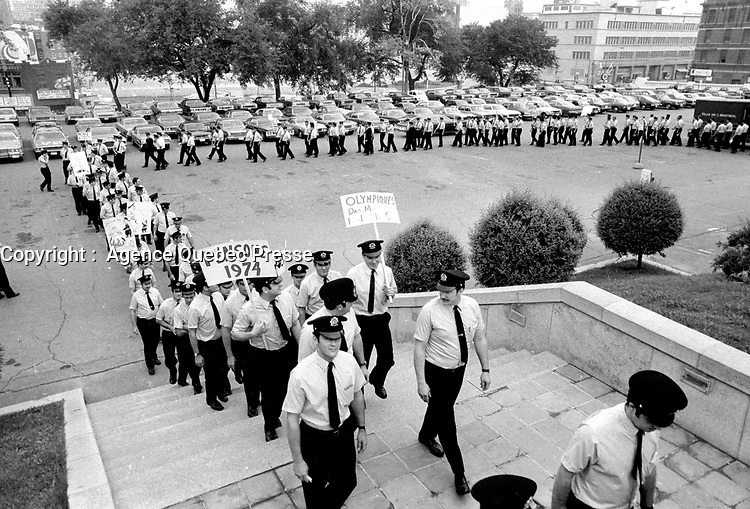August 1973 File Photo (exact date unknown) - Montreal firemen walk peacefully on Montreal City Hall requesting a salary increase which was refused until they went on strike illegally from October 31 to November 3, 1974 resulting in over 140 buildings burned.