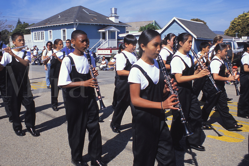 mixed ethnic gender high school students marching band clarinets