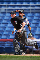 Umpire Ryan Wills gets in position as catcher Eliezer Zambrano (2) looks on during a game between the Richmond Flying Squirrels and Binghamton Mets on June 26, 2016 at NYSEG Stadium in Binghamton, New York.  Binghamton defeated Richmond 7-2.  (Mike Janes/Four Seam Images)