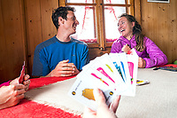 The Ortler Group in northern Italy is a popular region for spring ski touring using the huts for overnights to ski all the many peaks in the mountain group. Inside the Rifugio Branca skiers play card games.