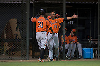 AZL Giants Orange relief pitcher Jorge Labrador (86) congratulates Beicker Mendoza (31) with a hug during an Arizona League game against the AZL Athletics at Lew Wolff Training Complex on June 25, 2018 in Mesa, Arizona. AZL Giants Orange defeated the AZL Athletics 7-5. (Zachary Lucy/Four Seam Images)