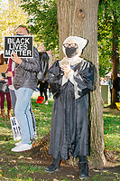 A crowd gathers in Boston Common for the 2020 Women's March protest in opposition to the re-election of US president Donald Trump in Boston, Massachusetts, on Sat., Oct. 17, 2020.<br /> A woman in this picture is dressed as the recently-deceased Supreme Court Justice Ruth Bader Ginsburg, wearing her trademark lace collar of dissent.