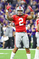 Indianapolis, IN - December 1, 2018: Ohio State Buckeyes defensive end Chase Young (2) pumps up the fans during the Big Ten championship game between Northwestern  and Ohio State at Lucas Oil Stadium in Indianapolis, IN.   (Photo by Elliott Brown/Media Images International)