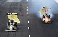 Feb. 20, 2010; Chandler, AZ, USA; NHRA top fuel dragster driver Tony Schumacher (left) races alongside teammate Cory McClenathan during qualifying for the Arizona Nationals at Firebird International Raceway. Mandatory Credit: Mark J. Rebilas-