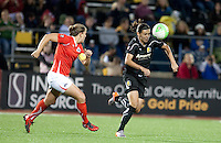 Christine Sinclair (right) heads the ball continue play against Cat Whitehill (left). FC Gold Pride tied the Washington Freedom 0-0 at Pioneer Stadium in Hayward, California on August 14th, 2010.