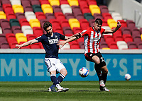 17th April 2021; Brentford Community Stadium, London, England; English Football League Championship Football, Brentford FC versus Millwall; George Evans of Millwall kicks the ball out past Vitaly Janelt of Brentford