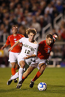 Virginia Tech Hokies defender James Shupp (4) chases Wake Forest Demon Deacons forward Zack Schilawski (12) during an NCAA College Cup semi-final match at SAS Stadium in Cary, NC on December 14, 2007. Wake Forest defeated Virginia Tech 2-0.