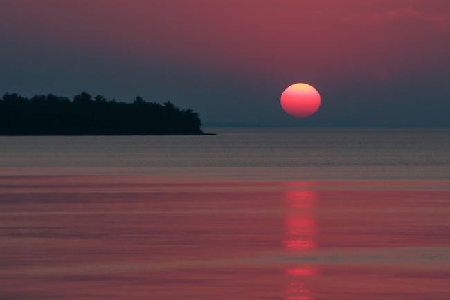 red sun, solstice sunset, Lake Superio