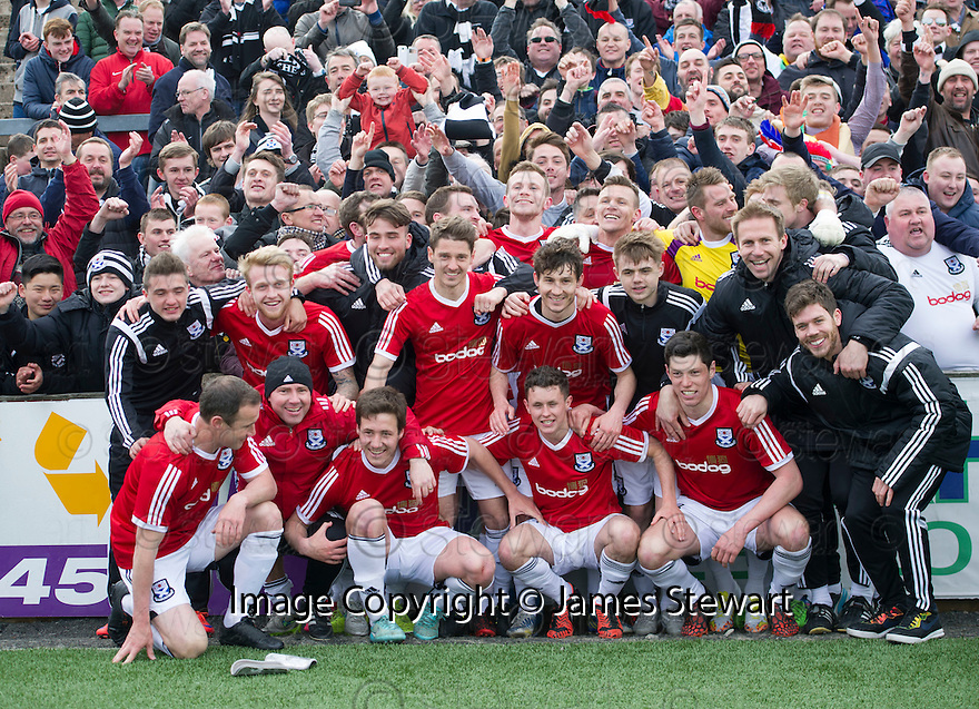 Ayr Utd players celebrate with fans after securing their place in League One.