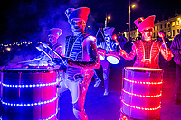 BNPS.co.uk (01202 558833)<br /> Pic: MaxWillcock/BNPS<br /> <br /> Lighting up the night.<br /> <br /> Pictured: The Spark! drummers perform to the crowds during the Sense of Unity parade through Weymouth in Dorset.<br /> <br /> Spark! is a street theatre show performed by five characters that combines high-impact drumming, dynamic choreography and beautiful lighting design.