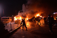 Rioters torch police trucks  throwing  molotov cocktails during the   protest against new draconian law to ban the right to  protest across the country.  Kiev. Ukraine