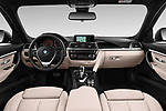 Stock photo of straight dashboard view of a 2018 BMW 3 Series Touring 330i xDrive 5 Door Wagon