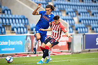 Andrea Radan of Oldham Athletic stops the forward progress of Miles Welch-Hayes of Colchester United during Colchester United vs Oldham Athletic, Sky Bet EFL League 2 Football at the JobServe Community Stadium on 3rd October 2020