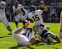 Pitt linebacker Mike Caprara (30) tackles Virginia quarterback Matt Johns in the endzone for a safety. The Pitt Panthers football team defeated the Virginia Cavaliers 26-19 on Saturday October 10, 2015 at Heinz Field, Pittsburgh, Pennsylvania.