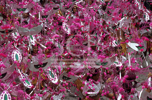 Rio de Janeiro, Brazil. Carnival parade; Pink pompom, silver and gold costumes with mask theme.