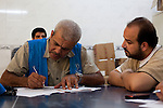 QAIM, IRAQ: A UNHCR worker registers Syrian refugees at the Qaim refugee camp in Iraq...Over 4,450 Syrian refugees have fled the violence in Syria and are living in the Qaim refugee camp in Iraq...Photo by Ali Arkady/Metrography